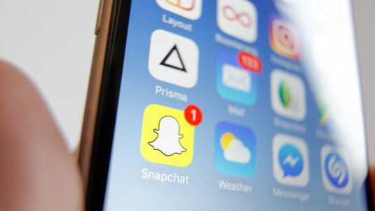 The Snapchat social messaging app is seen on an iPhone. The apps parent company Snap Inc recently had its first Initial Public Offering (IPO) on the New York Stock Exchange and was valued at almost 18 billion US dollars.