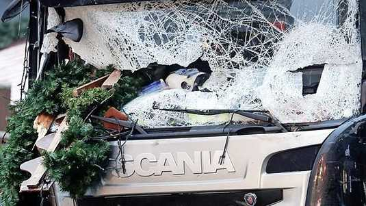 FILE - In this Dec. 20, 2016 file photo, Christmas decoration are stuck in the smashed window of the cabin of a truck which ran into a crowded Christmas market. The death toll from the attack was 12. In Britain, a man drove a car into pedestrians in London on March 22, 2017, in an attack claimed by the Islamic State group. The extremist group is encouraging its followers to use vehicles to achieve bloodshed. (AP Photo/Markus Schreiber, File) ORG XMIT: LFG103