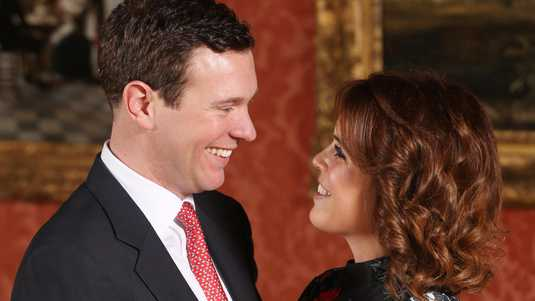 ALTERNATE CROP Princess Eugenie and Jack Brooksbank in the Picture Gallery at Buckingham Palace in London after they announced their engagement. Princess Eugenie wears a dress by Erdem, shoes by Jimmy Choo and a ring containing a padparadscha sapphire surrounded by diamonds.