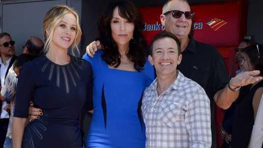 Sagal (2-L) poses with her fellow cast members from the television show 'Married With Children' US actress Christina Applegate (L), US actor David Faustino (2-L) and US actor Ed O'Niell (R)
